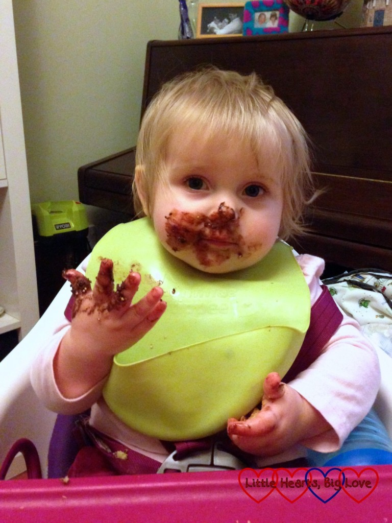 Baby Sophie with her face covered in chocolate
