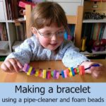 Making a bracelet using a pipe-cleaner and foam beads