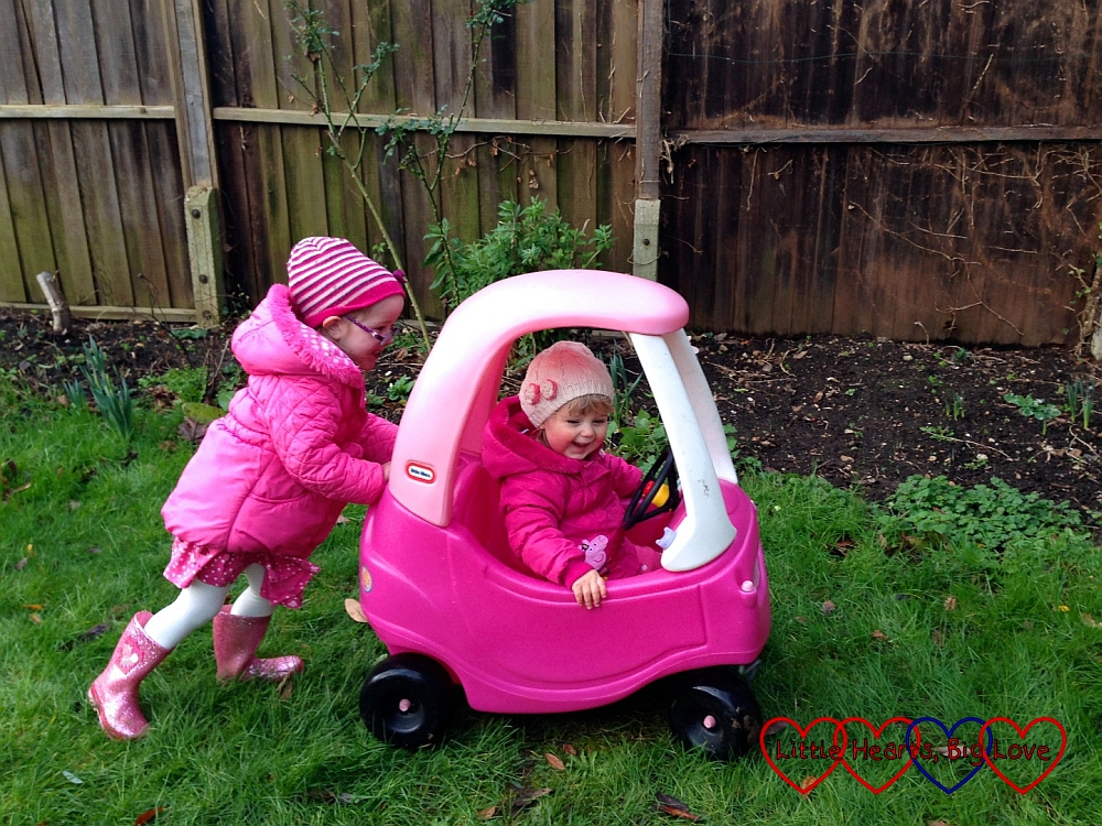Playing with the cosy coupe car - Outdoor fun: creating a nature collage in the garden - Little Hearts, Big Love