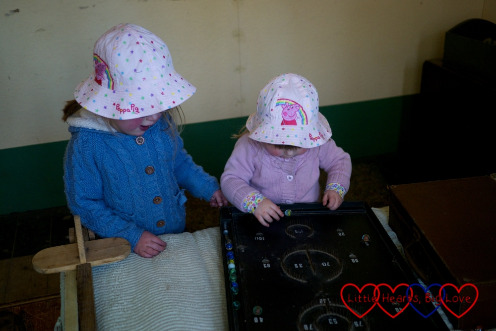 Playing pinball in the Amersham prefab - Easter fun at Chiltern Open Air Museum - Little Hearts, Big Love