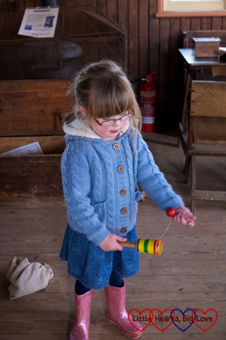 Playing cup and ball - Easter fun at Chiltern Open Air Museum - Little Hearts, Big Love