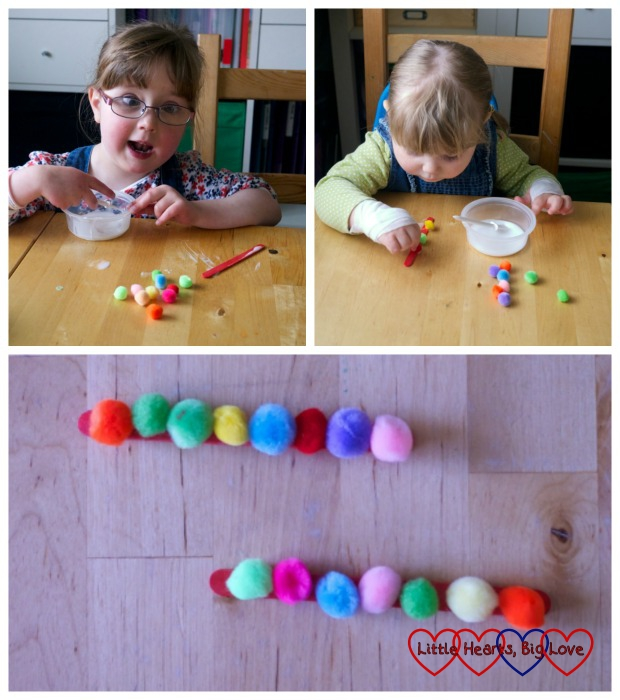 Caterpillars made from craft sticks and pompoms