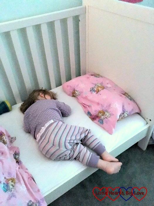 Sophie sleeping in a big girl bed
