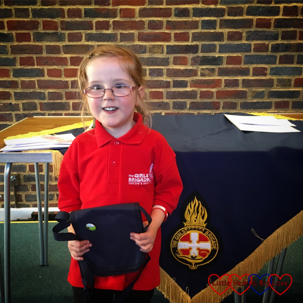 My big girl with her first ever badge after the Girls' Brigade awards evening