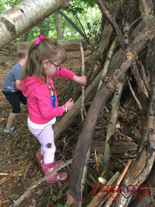 Jessica helping to build a den