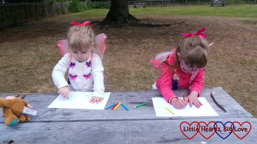 Jessica and Sophie drawing some pictures of fairies in the woods