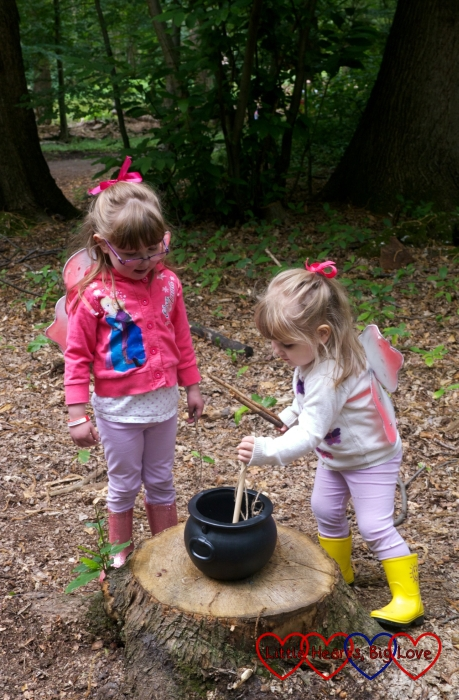 Jessica and Sophie mixing up a potion in a cauldron