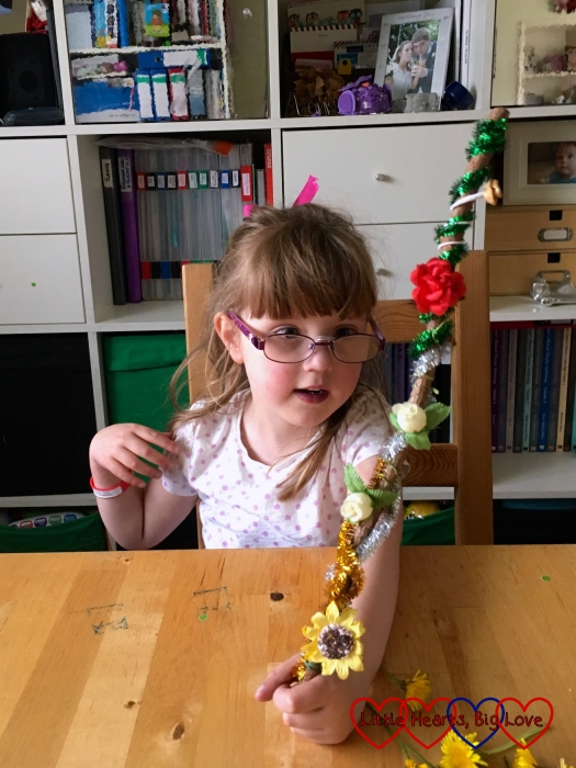 Jessica with her sparkly fairy wand made from a stick, sparkly pipe cleaners and paper flowers