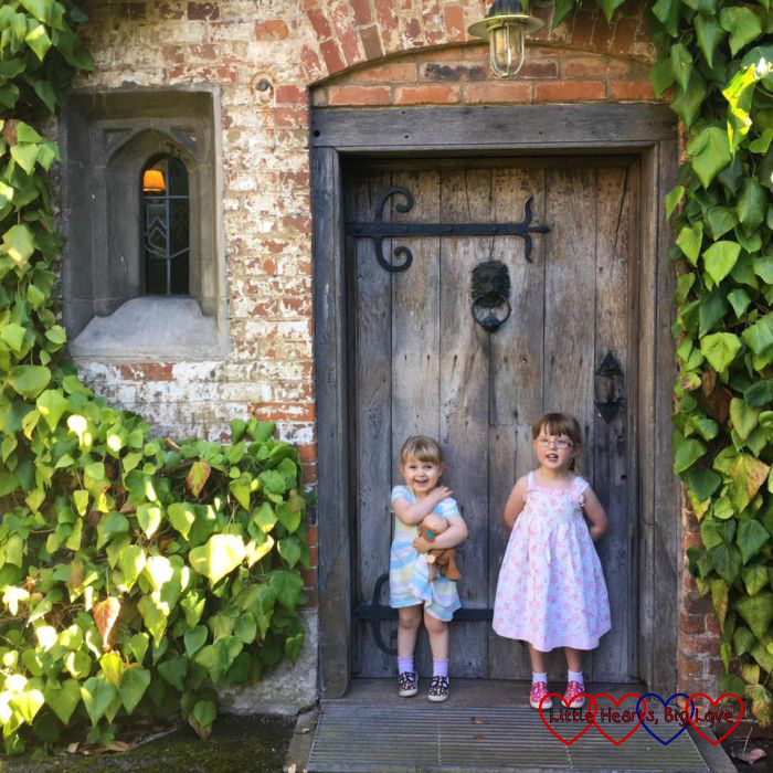 Jessica and Sophie standing in front of a pretty door at Baddesley Clinton