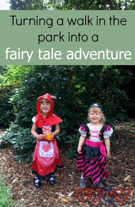 """Jessica dressed as Little Red Riding Hood and Sophie dressed as a pirate with the text """"Turning a walk in the park into a fairy tale adventure"""""""
