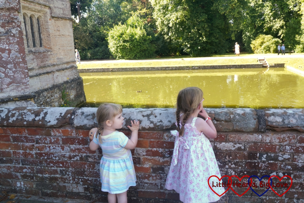 Jessica and Sophie looking across the moat at Baddesley Clinton