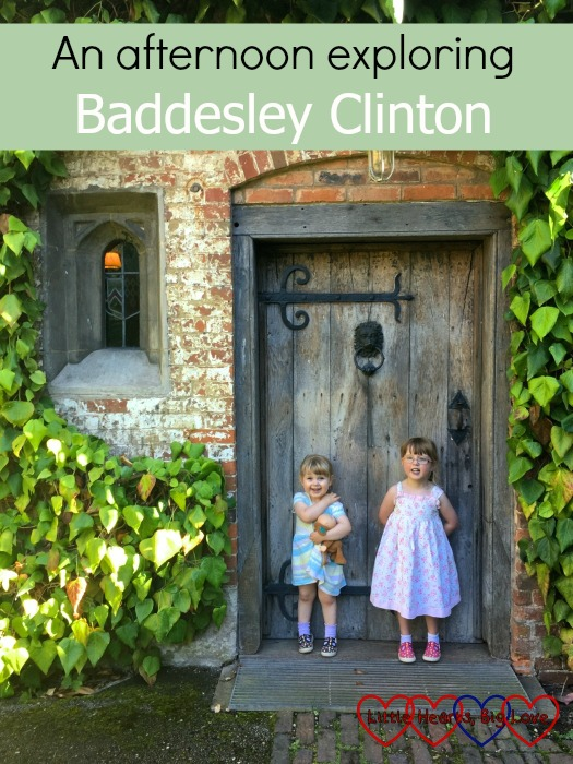 The girls in front of a door in the inner courtyard at Baddesley Clinton