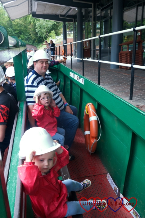 Hubby and the girls sitting on the boat ready to go into the Dudley tunnel