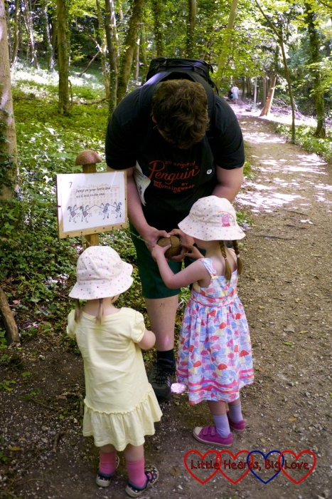 Hubby showing Jessica and Sophie how to use the coconut shells to make noises like horses' hooves