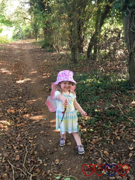 "Sophie with her ""fairy wand"" ready to make magic in the woods"