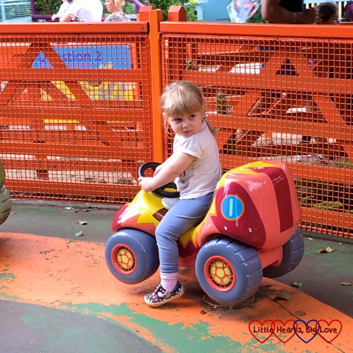Sophie on one of the cars on the Numtums Number-Go-Round ride