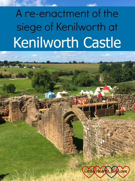 "Looking across the ground of Kenilworth Castle to where the re-enactment of the siege was taking place with the text ""A re-enactment of the siege of Kenilworth at Kenilworth Castle"""