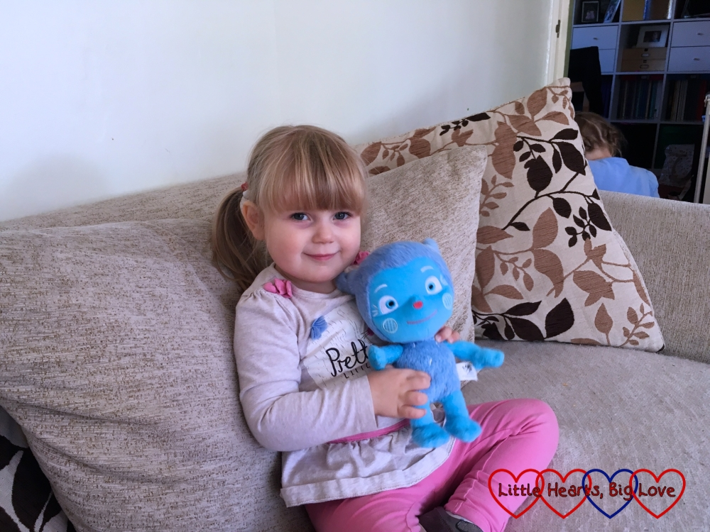 Sophie sitting on the sofa holding Messy Monster