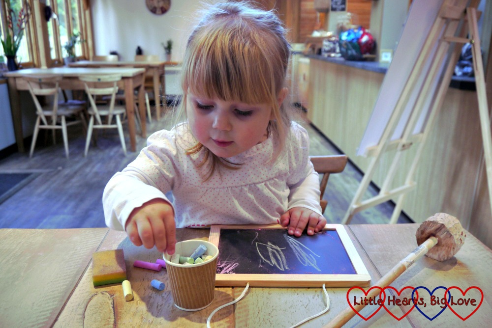 Sophie checking out which colour chalk to use on her chalkboard