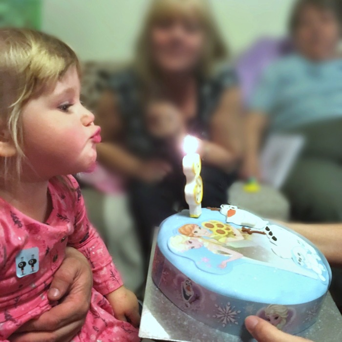 Sophie blowing out the candle on her birthday cake