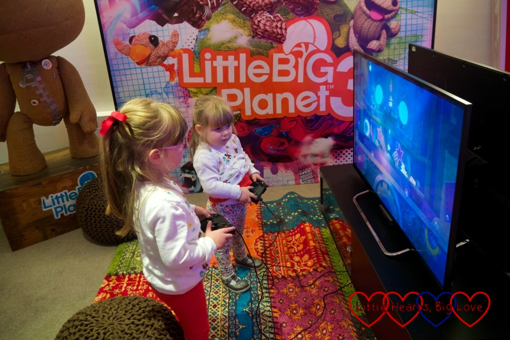Jessica and Sophie playing Little Big Planet 3