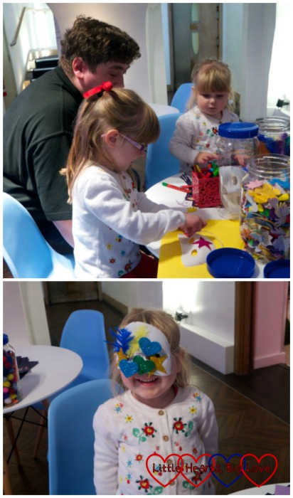 Jessica and Sophie having fun at the craft table making masks