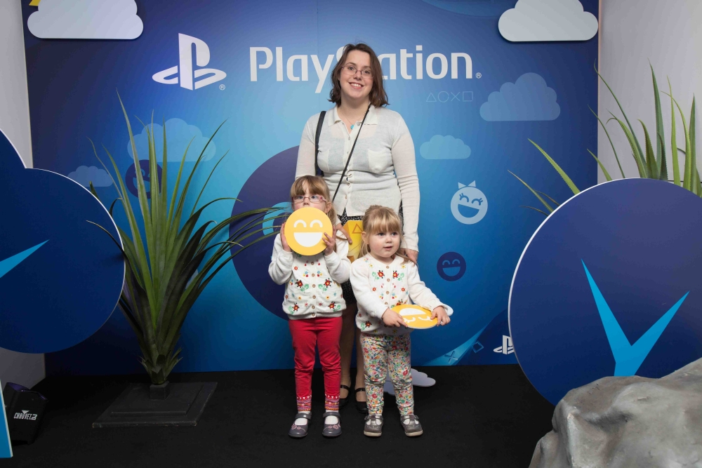 Me, Jessica and Sophie standing in front of the PlayStation board