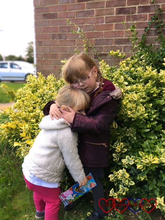 Jessica giving Sophie a big cuddle after school