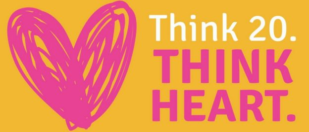"A pink heart on a yellow background with the text ""Think 20. THINK HEART."""