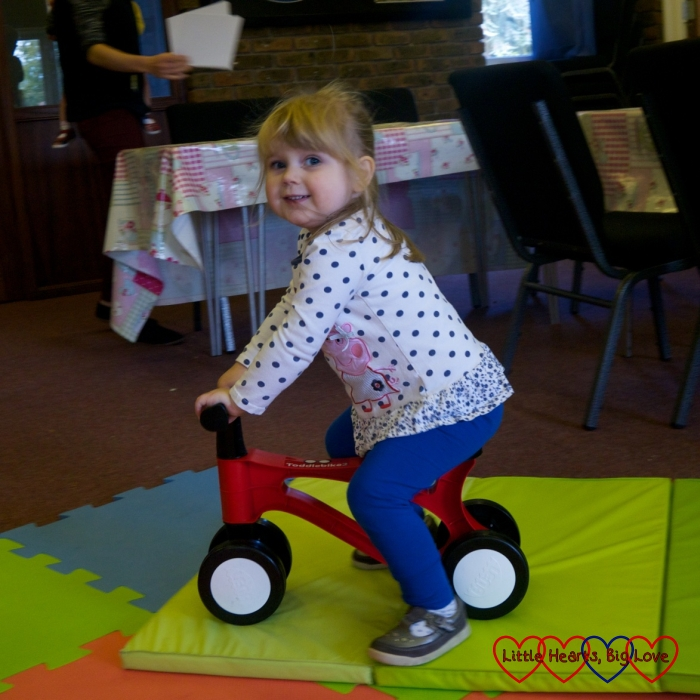 Sophie riding the Toddlebike2 at toddler group