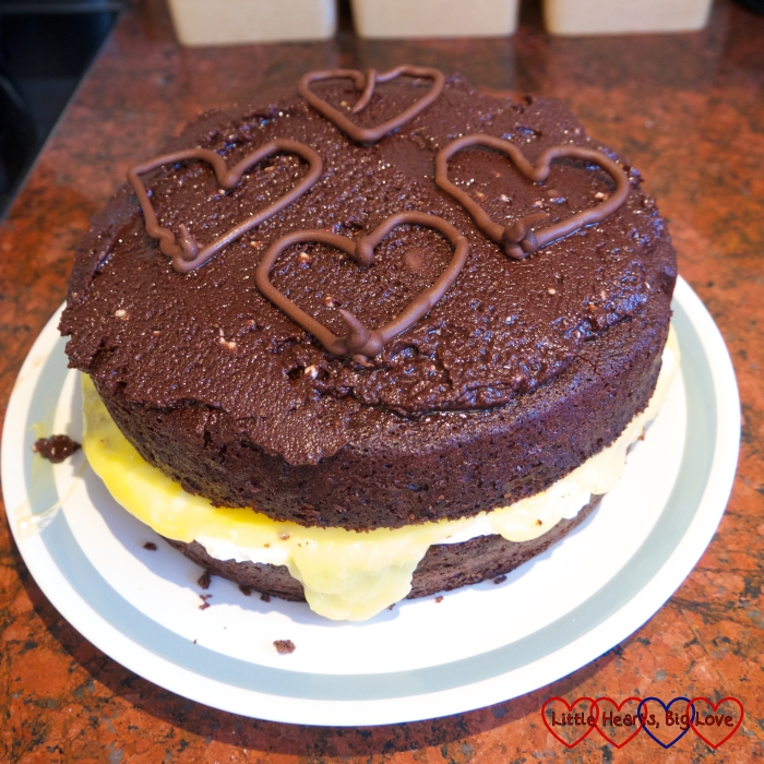 A chocolate layer cake with a passionfruit curd and cream filling