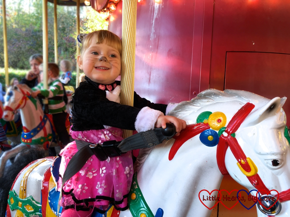 Sophie on one of the horses on the Thunder Blazer carousel