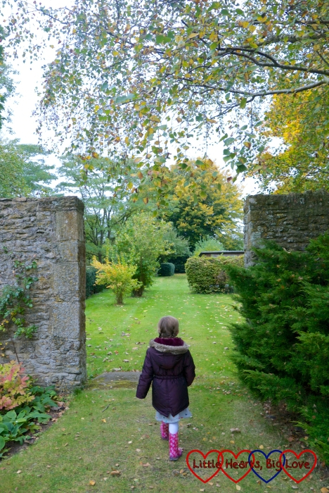 Jessica walking through an entrance into one of the gardens