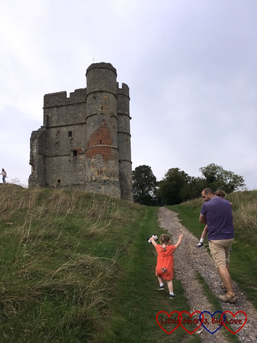 Neil and Sophie walking up the hill to the gatehouse