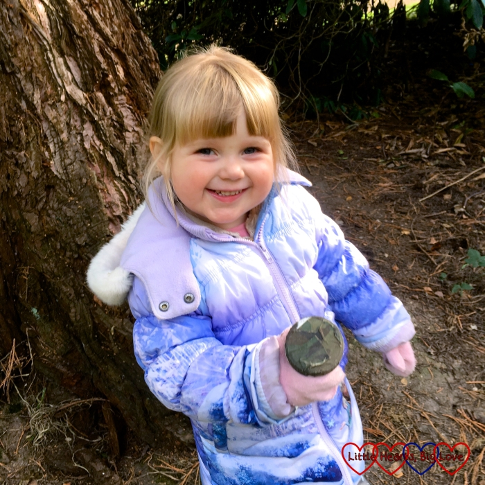 Sophie with a geocache that we found out on a walk