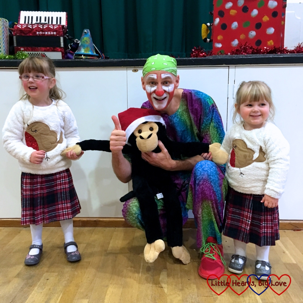 Jessica, Sophie and Monty the monkey with Scotty the clown