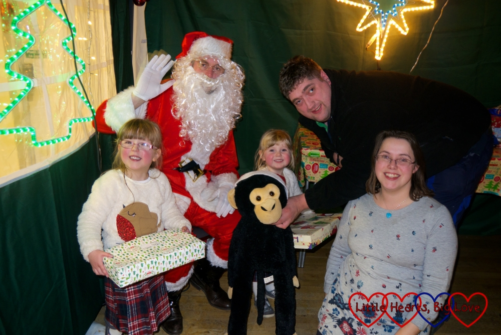 Me, hubby, Jessica, Sophie and Monty the monkey with Father Christmas