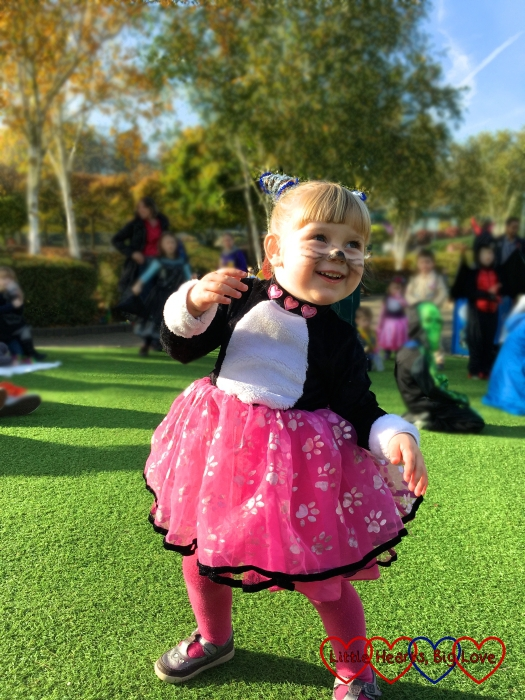 Sophie in her cat costume dancing along to the music at Legoland