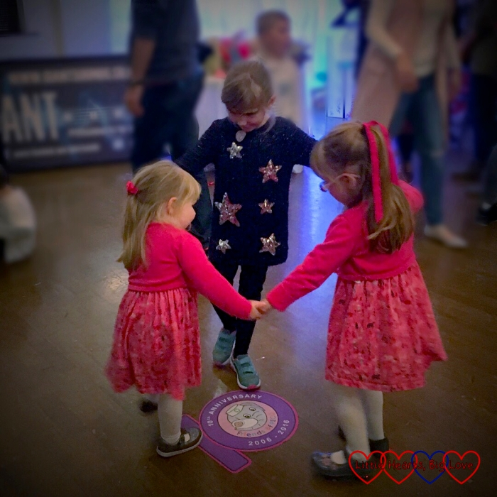 Jessica and Sophie dancing with their friend at the Friends of PICU 10th anniversary party