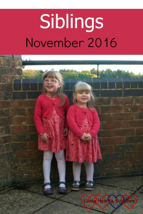 Jessica and Sophie in matching pink dresses and cardigans - Siblings November 2016