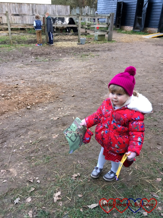 Sophie waiting in the farmyard before going to see Father Christmas
