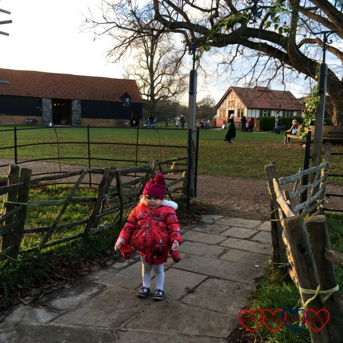 Sophie outside the Henton Mission Room on the village green at Chiltern Open Air Museum