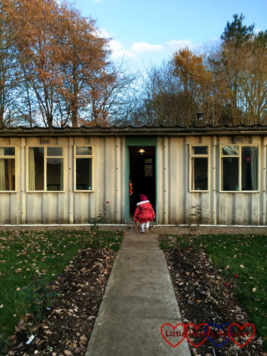 "Sophie heading into the ""playing house"" - otherwise known as the Amersham prefab"