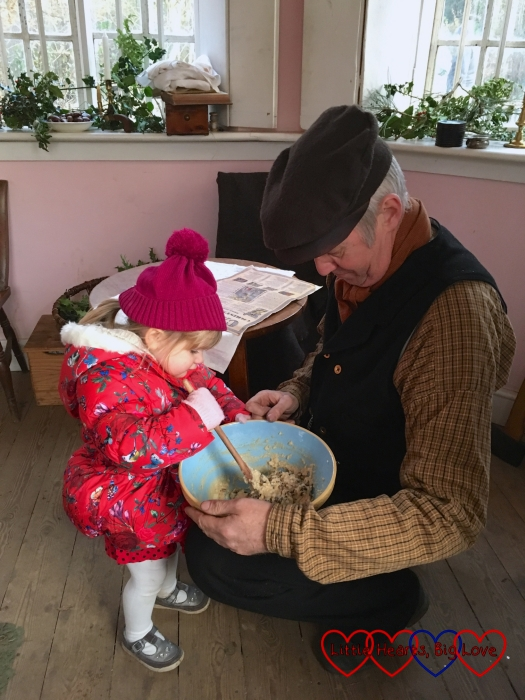 Sophie helping to stir the Christmas pudding at the Chiltern Open Air Museum