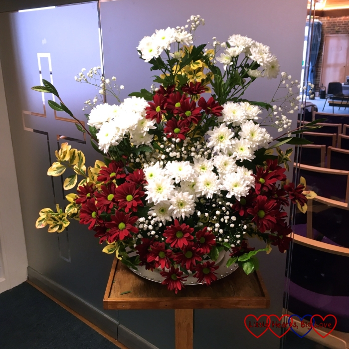 My first flower arrangement at church - red and white chrysanthamums in memory of my dad