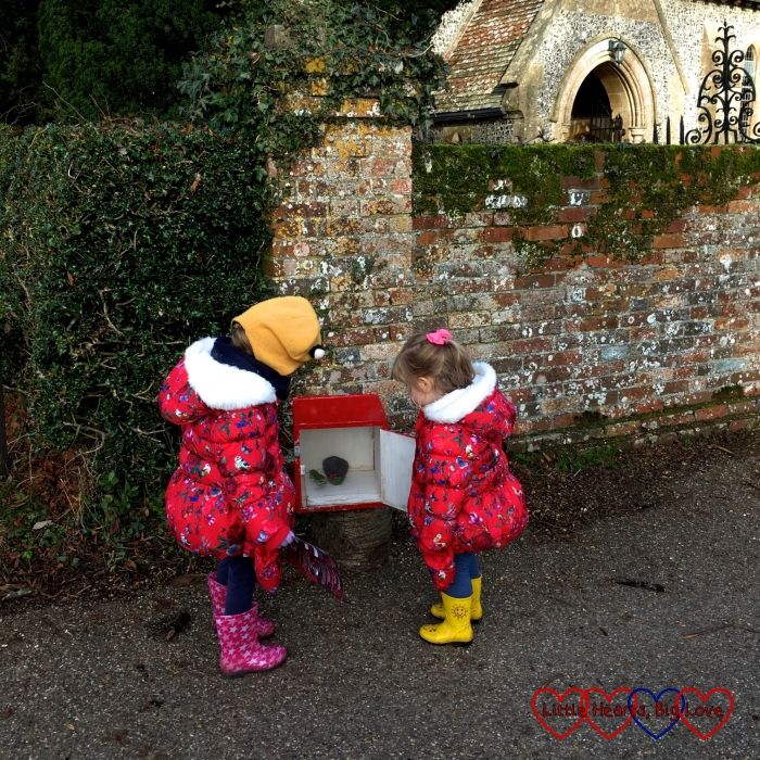 Sophie and Jessica opening one of the boxes next to the church at Hinton Ampner