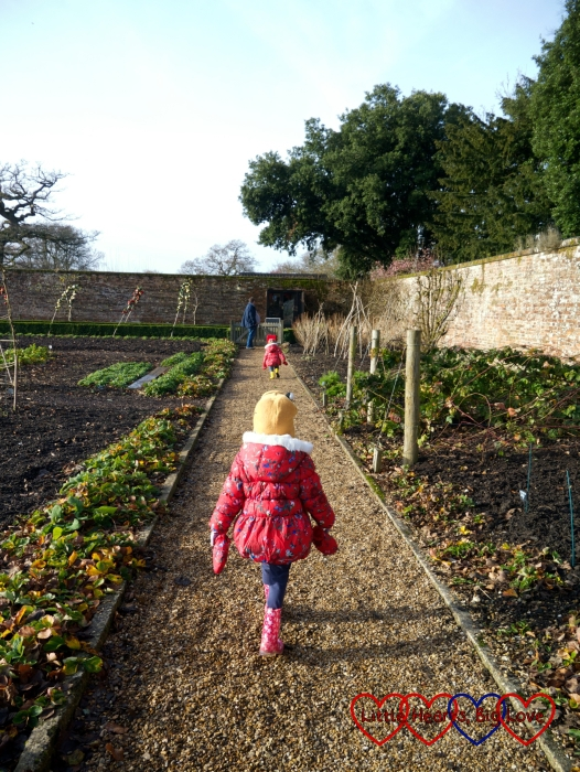 Jessica walking through the walled garden at Hinton Ampner