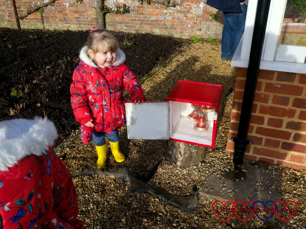 Sophie opening one of the advent boxes at Hinton Ampner