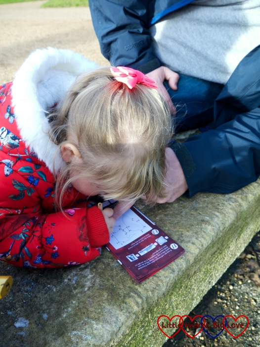 Sophie doing a dot-to-dot puzzle on the advent trail map