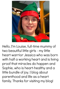 "Photo of me dressed as an elf with the text ""Hello, I'm Louise, full-time mummy of two beautiful little girls - my little heart warrior Jessica who was born with half a working heart and is living proof that miracles do happen and Sophie, who is heart-healthy and a little bundle of joy. I blog about parenthood and life as a heart family. Thanks for visiting my blog!"""
